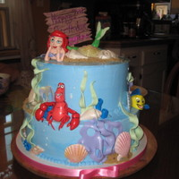 The Little Mermaid red velvet cake and white chocolate cake with white chocolate buttercream and fondant decorations