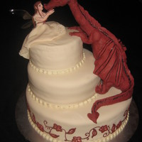 Fairy And Dragon Wedding Cake This is a wedding cake for a couple having their wedding at a zoo. They chose to have fairy resemble the bride. They wanted the fairy to be...