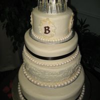 My First Wedding Cake Ivory buttercream with fondant pearls and chocolate brown satin ribbon. The B's are made from Wilton's new fondant and gumpaste...