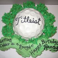 "Happy ""rough""day Golf ball in the middle of cupcakes with tall grass on the edge of the ""green"" smooth cupcakes."