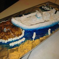 Rice Crispy Treat Motor Boat This is a motor boat, island and fish made from rice crispy treats. (that is why it looks so lumpy) It was for a 40th birthday for my...