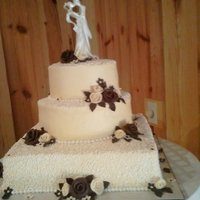 "Elegant Ivory Buttercream With Cornelli Lace & Fondant Pearl This was a three tier wedding cake in 7"", 10"", 14"", done in dark ivory buttercream with white cornelli accents, handmade..."