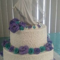Purple & Teal Traditional  Really hard to get a good shot of this cake due to lighting & colors used ... purple & teal gumpaste roses with a cornelli lace...