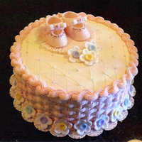 Baby Shower Cake I made this for my daughter's baby shower. White cake with lemon curd filling, buttercream icing & fondant shoes & flowers....