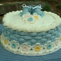 """baby Boy"" Shower Cake White cake with lemon filling. Frosted with buttercream. CC baby booties & flowers provided inspiration. I am sorry that I do not..."