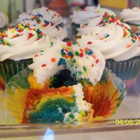 Rainbow Cupcakes these was an invention i thought of and made...so i colored the batter and made rainbow cup cakes they are a HIT