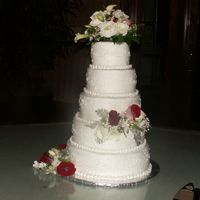 Round Cake, Scrollwork, 5 Tier, Inspired By This Site!` The bride had shown me a picture from this site...bottom tier is buttered pecan, next is white with Raspberry filling, then chocolate with...