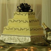 Square Wedding Cake, Ivory With Scrollwork, Chocolate Fondant Bow This is my beautiful daughter-in-law's cake that I made for their wedding this past weekend. She chose an Ivory square cake, with...
