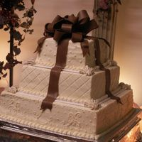 Square Wedding Cake With Chocolate Fondant Bow This cake was chosen by the bride on Cakecentral, (JENN123). Added the fleur-de-lis details to cover the corners of the plastic divider...