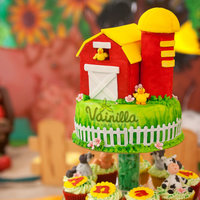 Farm Animals Farm themed cupcake tower.Cupcakes where vanilla with italian meringue swirls, the animals are gumpaste. the top cake was vanilla filled...