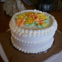 "Buttercream With Roses And Tiger Lillies This is a 6"" buttercream w/ buttercream flowers. It was actually a cake that bride purchased to take to her family to taste, but I..."