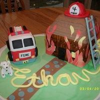 Fireman Cake This is a fireman cake I did for a little boy's birthday. Fondant for just about everything. Fire engine and house are cake. Fireman,...