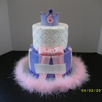 "Princess Cake   Chocolate 8"" cake on bottom and white 6"" cake on top. buttercream with fondant details. Plastic gems on tiara."