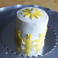 Yellow Flowers Cake Buttercream and fondant covering a yellow gold cake.