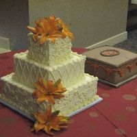 Orange Lilies Buttercream and beautiful orange lilies for the bride and groom - Texas Longhorn fans