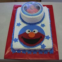 Elmo Sheet cake with Elmo face made out of fondant.