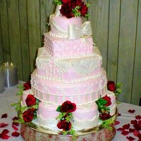 Valentine's Day Romantic Wedding The pink icing is smooth butter cream with pearlized fondant accents.