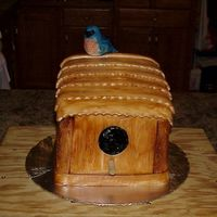 Birdhouse With Bluebird This is birdhouse cake with a little bluebird sitting on top bluebird is sculpted out of candy clay, and the rest is covered in fondant.