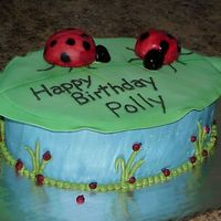 Lady Bugs this is a lady bug birthday cake ladybugs Are Made from cupcakes and fondant.