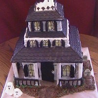 Haunted House Chocolate cake, cookies n cream filling. Roof made of chocolate, rails and post made from sugarpaste. Cake was made for a little girls 12th...