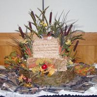 Duckhunter Groom's Cake A 2 tier chocolate cake with chocolate buttercream iced with a leaf tip.Cattails and fall foliage surround a little duck decoy with special...