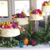 Tropical Themed Wedding 4-tiered cake on separate acrylic stand for a casual tropical beach wedding