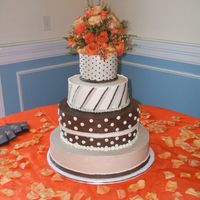 Brown And Beige Fall Wedding Shades of brown with varying dots and stripes accented with beautiful fall flowers in orange and fuschia