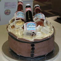 Budweiser Beer Barrel Cake Retirement cake for a friend's father who loves Budweiser. My first attempt at sugar beer bottles. Thanks to BRATTYR for answering my...