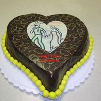 Chocolate Cake Frosted With Choc Bc/ganache  This is a chocolate cake frosted with choc BC then layered with two coats of ganache. Topped off with a choc heart covered with a choc...