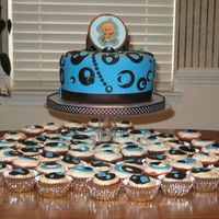 Modern Baby Boy   8 inch round cake with lots of cupcakes.