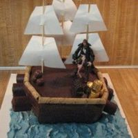 Pirate Ship This was two round cakes for the ship and one large rect cake for the water. I used white cake and chocolate icing for the ship and...