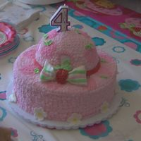 Eden's 4Th Birthday Cake Strawberry Shortcake's Hat! A yellow cake with fresh strawberry and cream filling. The icing is BC (almond and butter flavors). The...