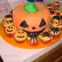 "Pun'kin Patch For a playgroup Halloween Party. Cake is 2 yellow Bundts ""glued"" together with whipped and bc icing. All decorations BC Icing......"