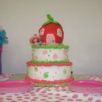 Strawberry Shortcake My daughter wanted a tiered cake for her 6th birthday. She ALSO wanted the strawberry shortcake house she saw here at CC... but she waited...