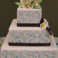 "Ashley 6 x 10 chocolate with choc bavarian cream; 14"" vanilla with cheesecake bavarian; royal icing stenciling; gumpaste calla lilies"