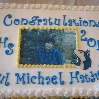 Graduation 12 x 18 chocolate sour cream, fondant accents, edible image
