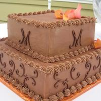 Kris 8 x 12; sour cream chocolate and wasc with chocolate buttercream icing.