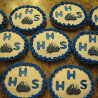 School Reunion My mom wanted cookies for her high school reunion; fondant over buttercream, edible image of school mascot.