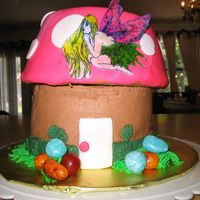 Mushroom Cake This is a vanilla cake with chocolate buttercream filling and icing. The top is covered in fondant with fondant accents. The fairy is based...