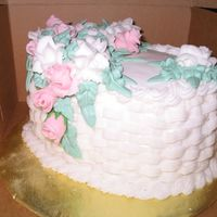Basket Weave Cake This is a vanilla cake with chocolate bavarian cream filing. The design is based on one of the Wilton Course cakes. Some of the flowers are...
