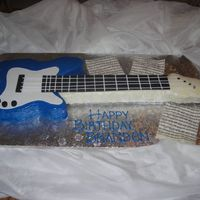 Brandon's Guitar i carved an 11x15 sheet for the body of the guitar and shaped rice crispy treats for the neck. Poured white chocolate ganache over the...