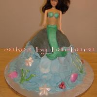 Mermaid Doll Cake mermaid doll cake. iced in buttercream, fondant accents, fondant tail.