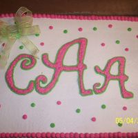 College Graduation I did this cake for a client graduating from college. She wantedher monogram on the cake. All buttercream w/bow made from ribbon.