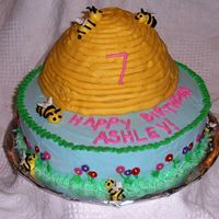 Bee Hive Birthday The hive was made with the Wilton wondermold. Frosted in BC, fondant flowers around base, bees on base are BC- bees on hive are mmf.