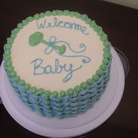 Baby Cake This baby shower cake is yellow cake, torted and filled with hazlenut mousse, and iced and decorated in Italian meringue buttercream. I...