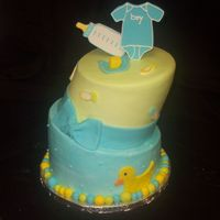 Whimsy Baby Shower Tilted cake for a baby shower. Iced in buttercream with fondant accents and toppers