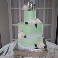 Magnolia Wedding I like this cake even though the middle tier came out too large. All butercream with gumpaste magnolias.