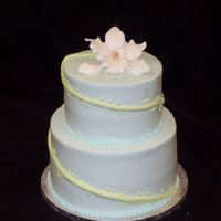 Orchid Iced in buttercream with gumpaste orchid