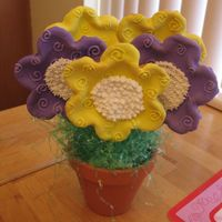 Cookie Bouquet My first cookie bouquet. I mailed it to my sister for her birthday! Sugar cookies with royal icing.