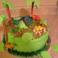 Dinosaur Cake This was for my friend's son's third birthday. It was the first time I tried making the palm trees and the leaves all fell off....